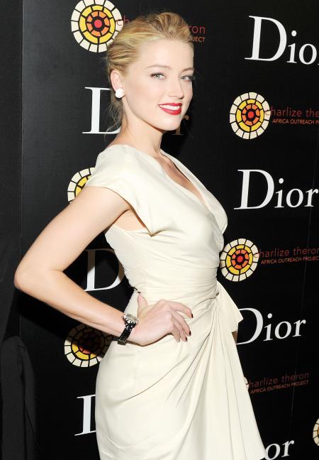L'actrice Amber Heard rayonnante lors de la soirée de lancement de la Dior VIII à New York.