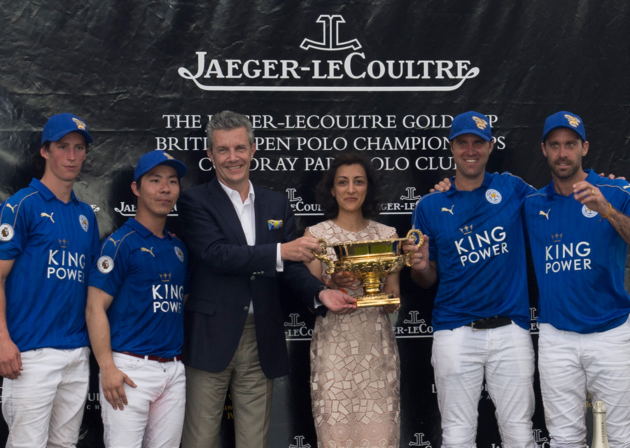 Jaeger-LeCoultre CEO Daniel Riedo, and UK Director Zahra Kassim-Lakha presenting the Trophy to the winning team King Power Foxes©Vanessa Taylor Photography